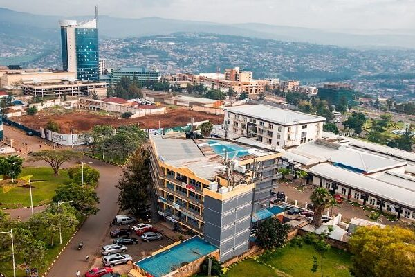 A-wide-panoramic-view-looking-down-on-the-city-center-with-Kigali-City-Tower-against-the-backdrop-of-distant-blue-hills